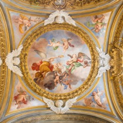 ROME  ITALY   MARCH 12  2016 The symbolic fresco of angels with the crown and guitar on the side cupola in Chiesa di Santa Maria del Orto by Giovanni Battista Parodi  1674   1730 .